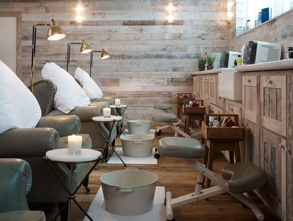 Nail treatment chairs at Cowshed Chicago.