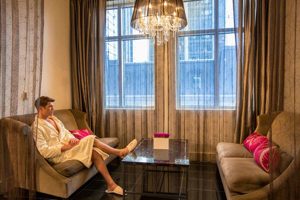 A guest enjoys the relaxation lounge at The Waldorf Astoria Spa and Health Club, Chicago.