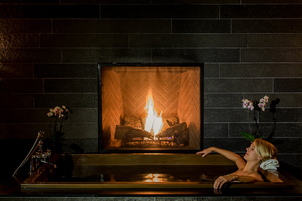 Guests of the Spa can relax in copper baths next to private fireplaces.