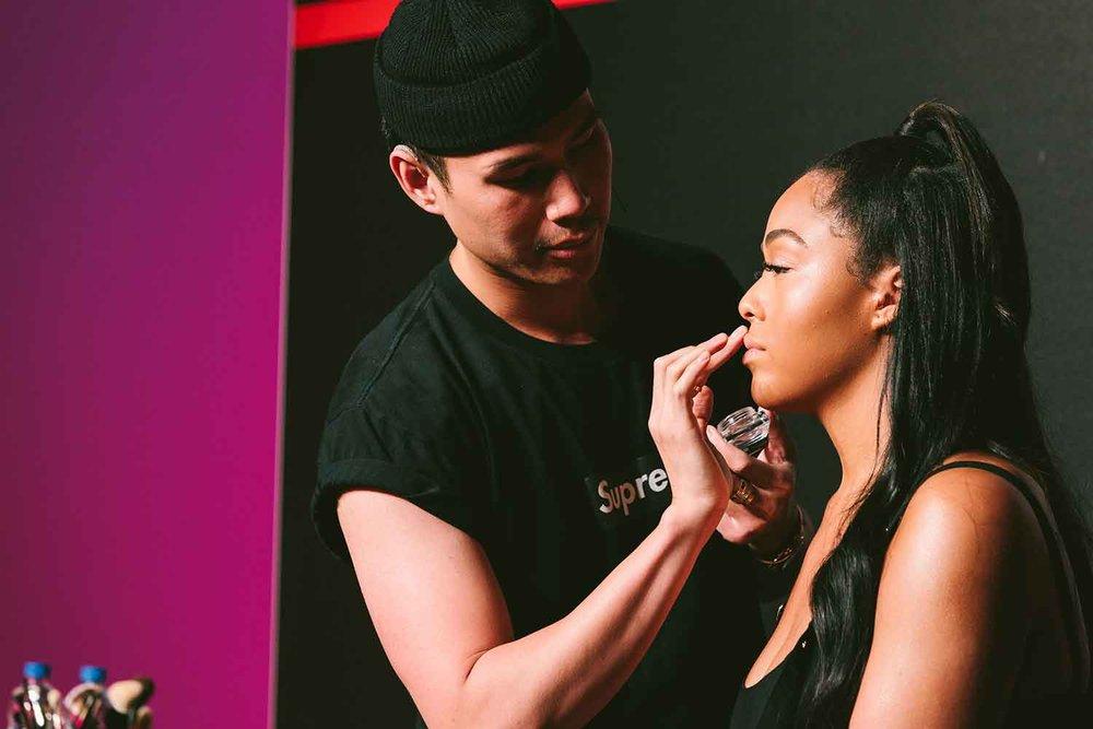 Celebrity makeup artist Patrick Ta demonstrates a monochromatic look on model Jordyn Woods.