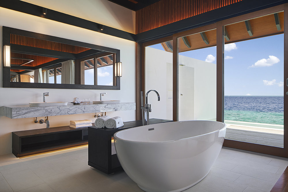 A bathroom with an ocean view in The Westin Maldives Overwater Suites.