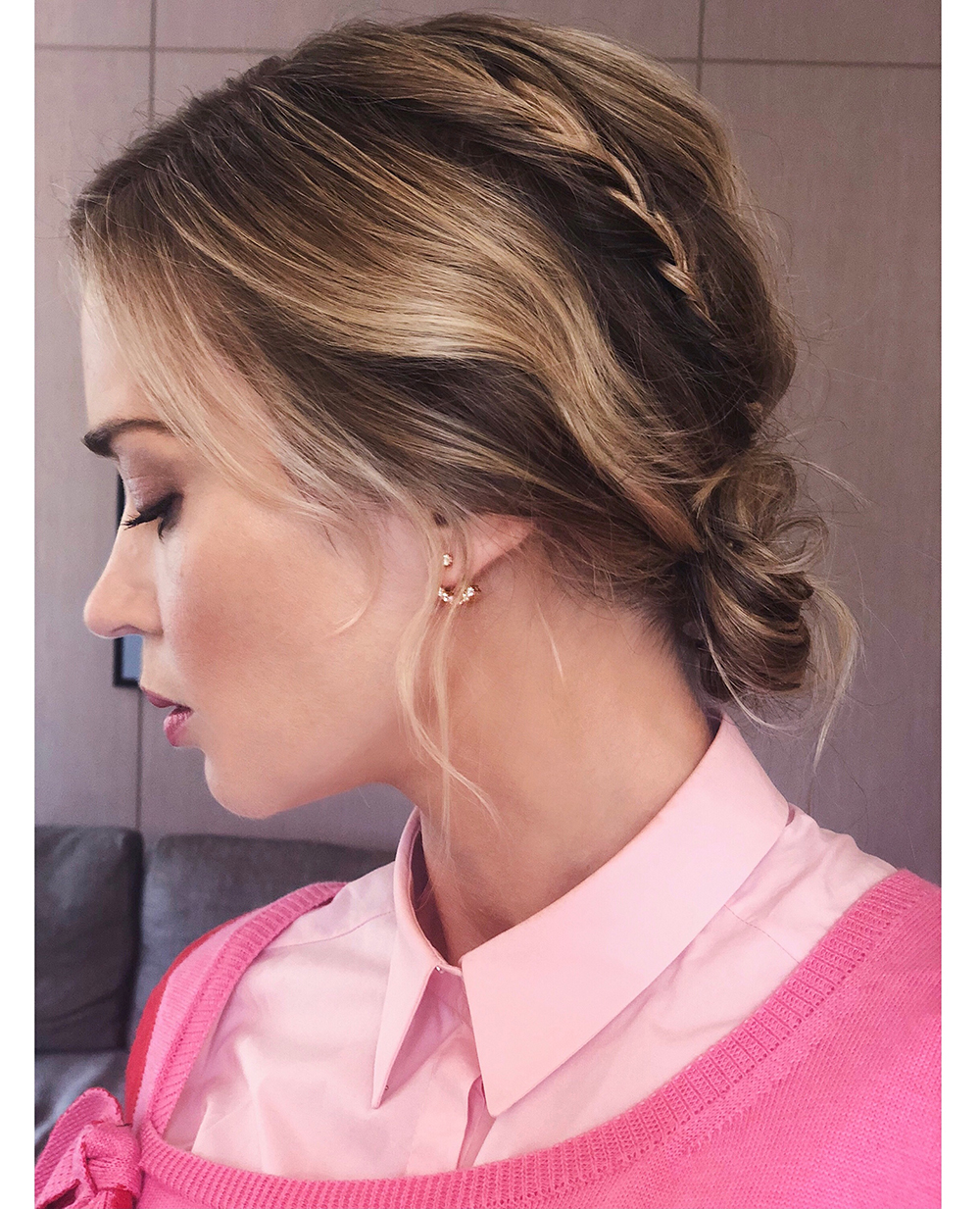 The style can be left down as a low ponytail or pulled into a loose bun.