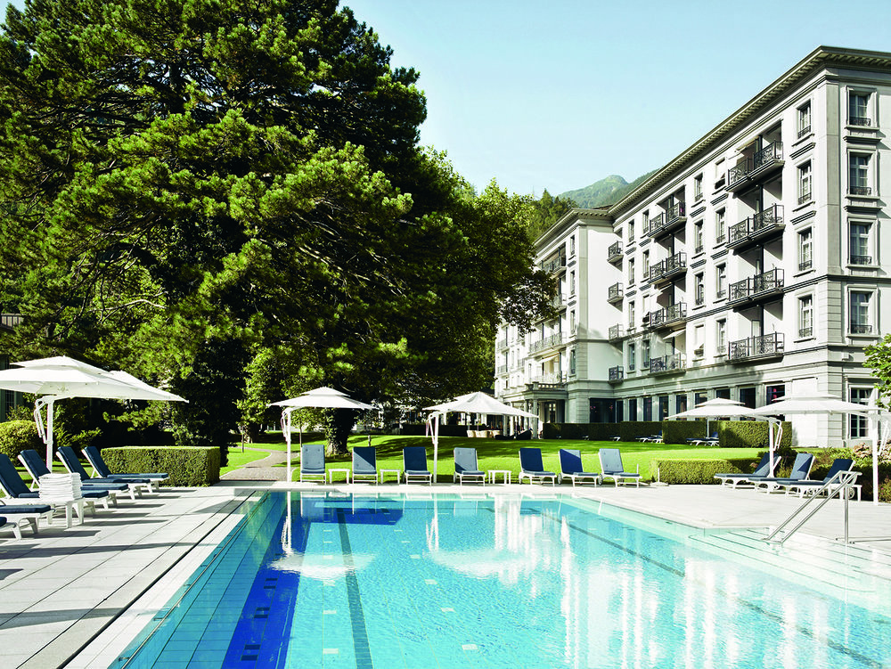 Guests also enjoy lounging by the garden swimming pool outdoors.