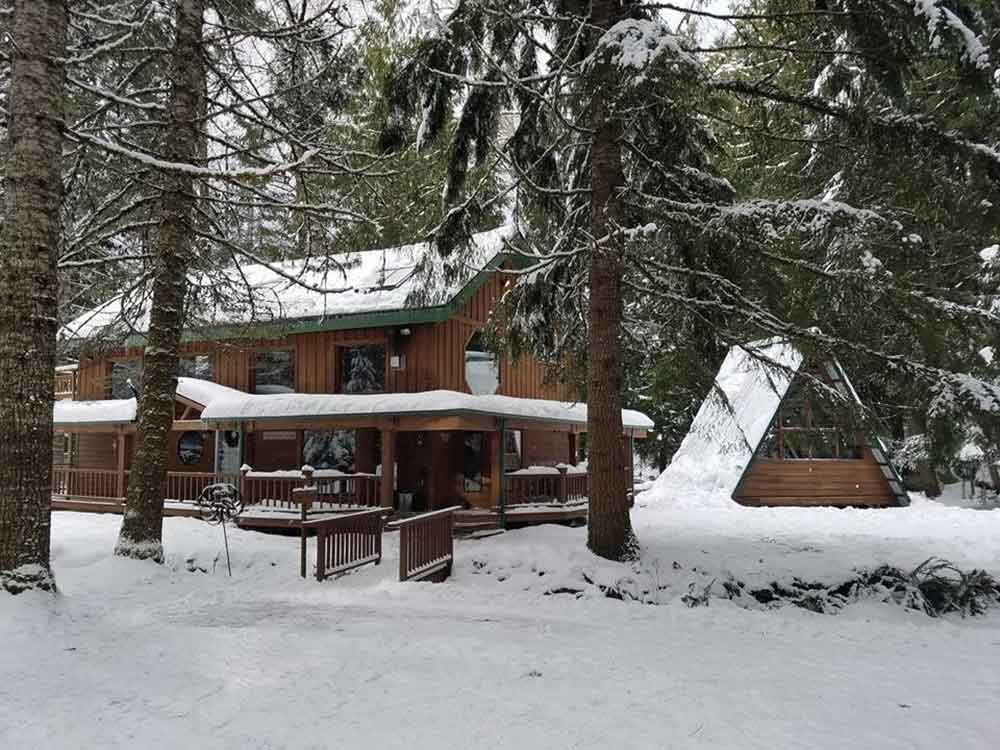 The Buchanan Bunkhouse sleeps 12 and features a saltwater hot tub in an open-air A-frame structure.
