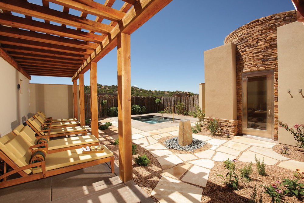 The relaxing outdoor lounge area with Jacuzzi.