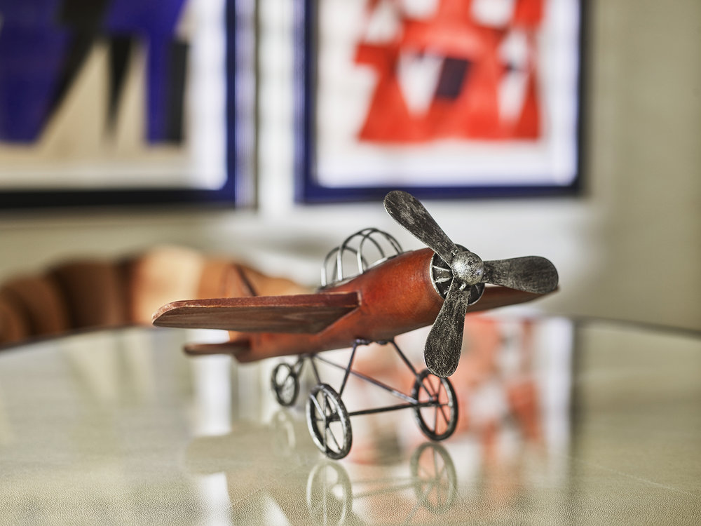 A collection of model airplanes are located throughout the suite.