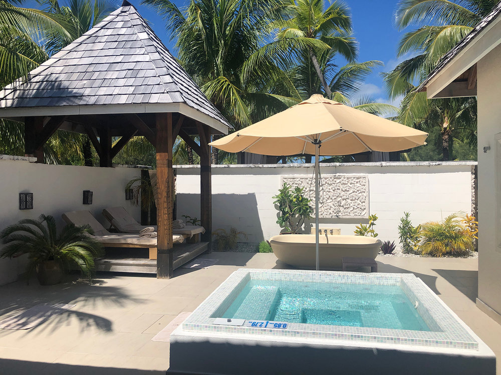 One of the spa's private wellness areas has a solar-heated hot tub and shaded pavilion for lounging.