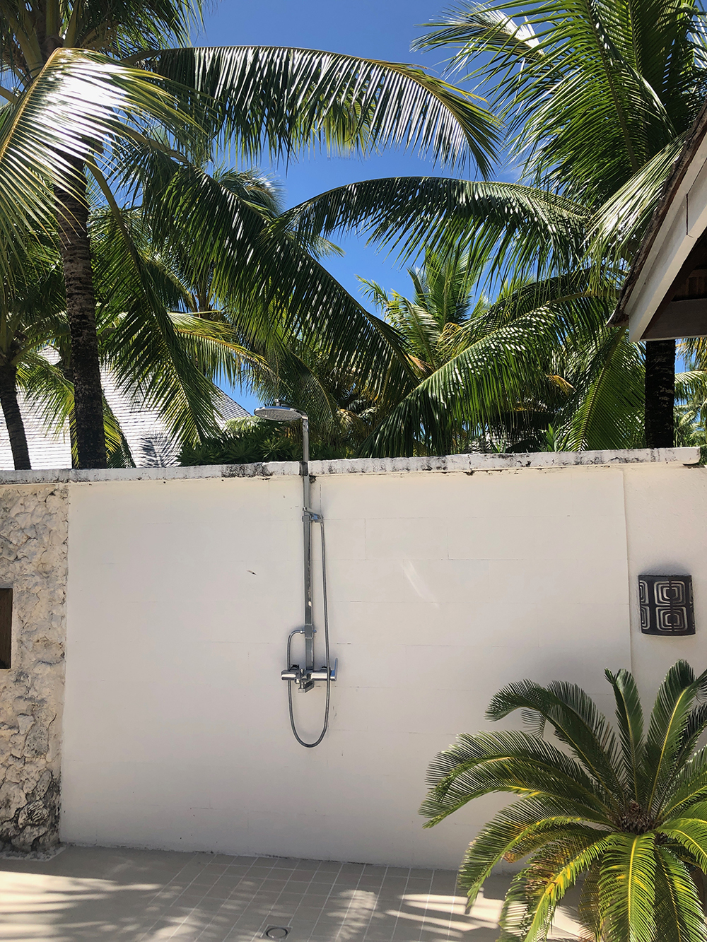 The refreshing outdoor shower in the private wellness area.