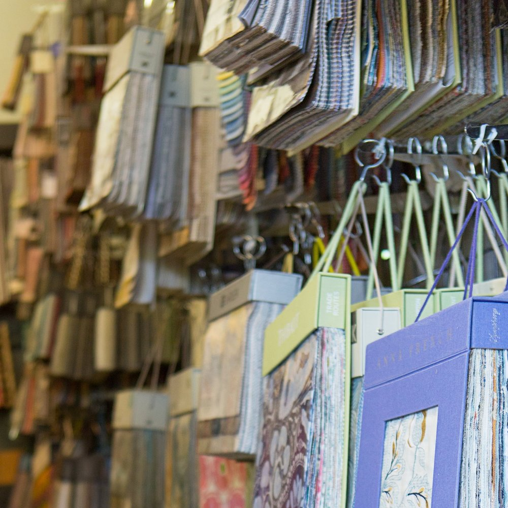 Browse our Fabric Library  Shop the widest selection of fabric, wallpaper and trim in the area, with more than 2,700 swatch books in our constantly evolving library. We work closely with high-end fabric houses to source textiles our customers can't help but fall in love with.