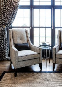 gray statement chair with dark throw pillow