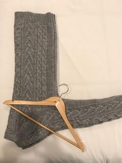 Hanger lying on top of folded sweater