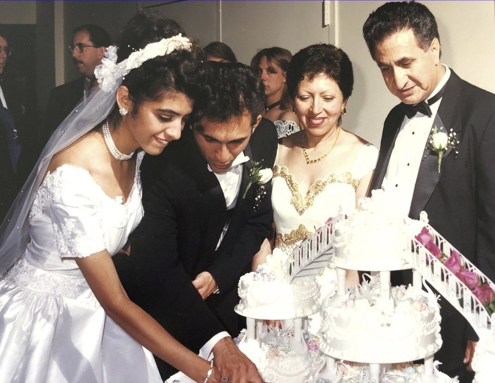 John and I cutting our wedding cake