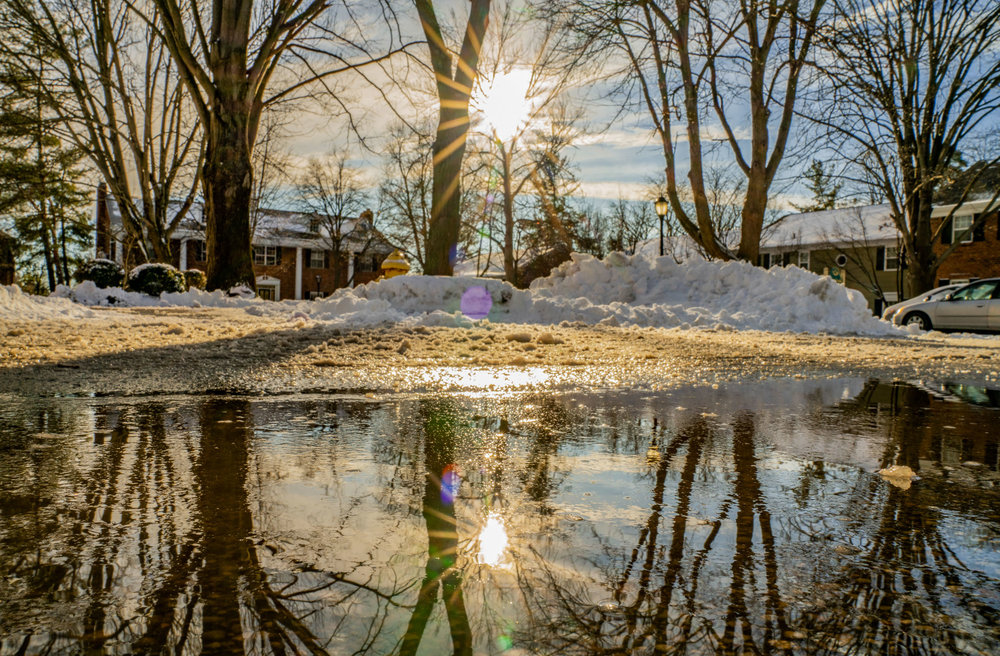 Puddle reflection with snow and star bursts