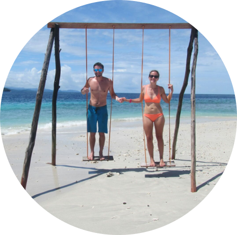 Having fun in the sun on the ocean swing - MahaRaja Eco Dive Lodge