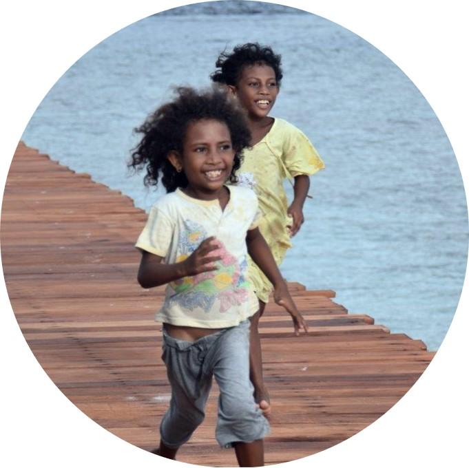 Papuan children playing at the MahaRaja Eco Dive Lodge in Raja Ampat
