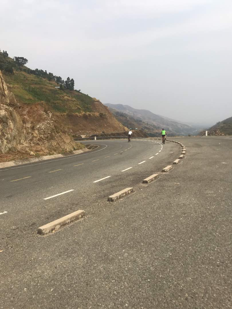 The new tarmac road twisting down the mountain side