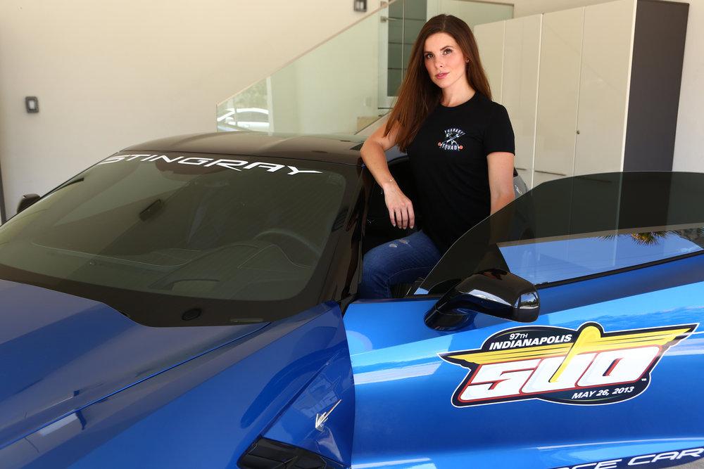 #SkinBabe Lauren Kanaan standing next to Tony Kanaan's pace car.