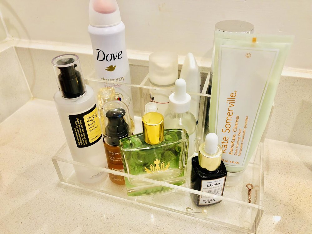 #SkinBabe Nikki Burdine's sink arrangement with her every day products: Luna Sleeping Night Oil, Kate Somerville Exfolikate cleaners, Elta sunscreen and Snail 96 mucin for spot treatment.