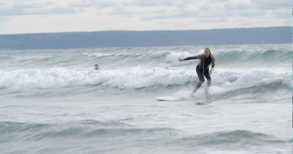 Elly Whittaker surfing in North Devon for Dead Pixel Films