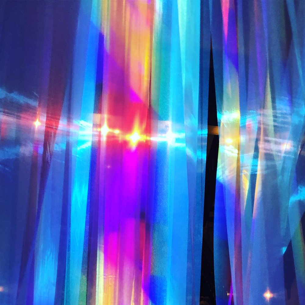 Lumina   An immersive environment where guests can experience stepping into an artwork of dancing colored light.