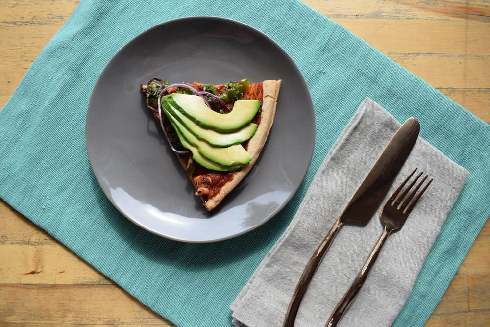 This is the green pepper, mushroom, onion pizza, topped with a healthy dose of avocado.