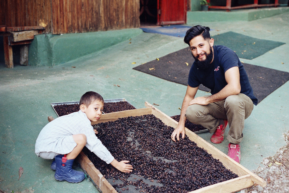 Christopher passing down to his son Aaron the secrets of the Patio sundried natural processs