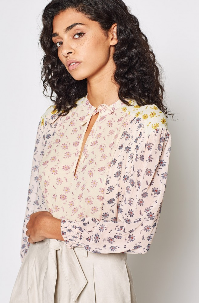 Silk Floral Top - A pretty print popover in perfectly mixed and faded hues, it is cut with plenty ofdrapefor easy tucking (or, better yet, half-tucking). Pair it with white jeans for a day look or dress it up with our Nicole Miller skirt.