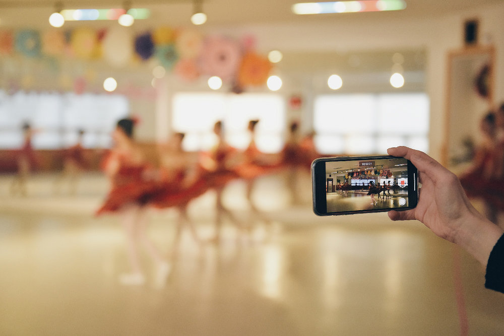 Dance mum filming ballet class on iPhone in York