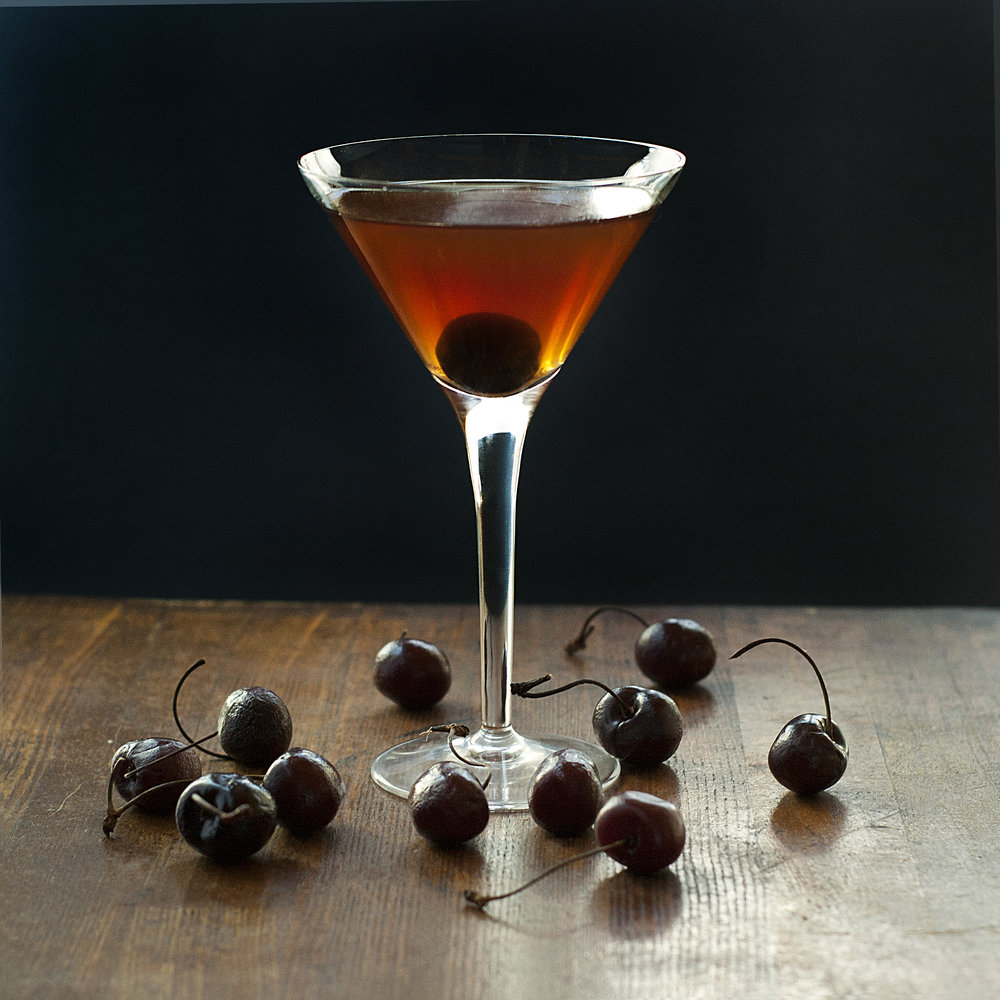 Cherry Cacao Rob Roy - Scotch whisky, sweet vermouth, chocolate cherry syrup cocktail