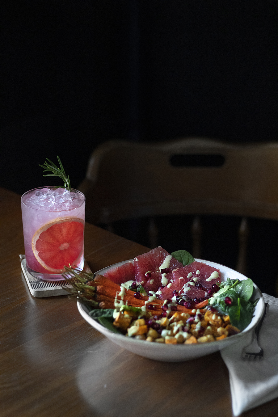 winter vegetable buddha bowl with honey dijon dressing and grapefruit pomegranate vodka sour