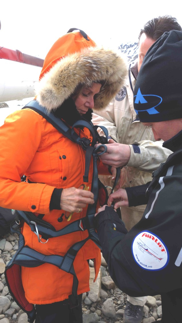 Getting outfitted to lean out the open helicopter door at 5000ft