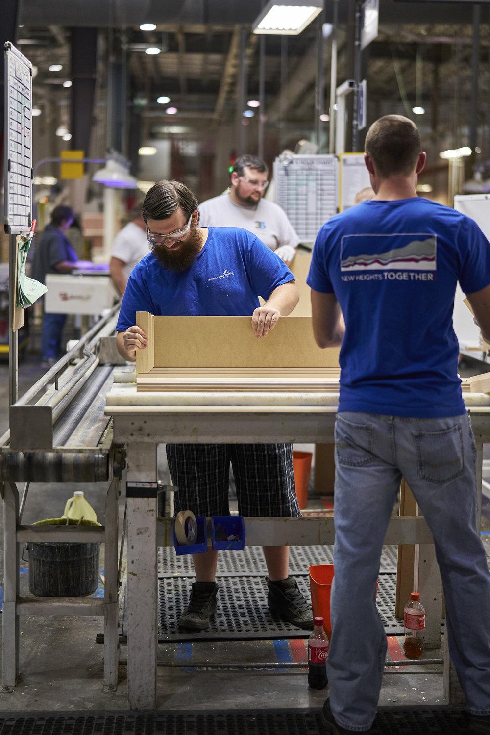 americanwoodmark_rustywilliams_manassembling.jpg