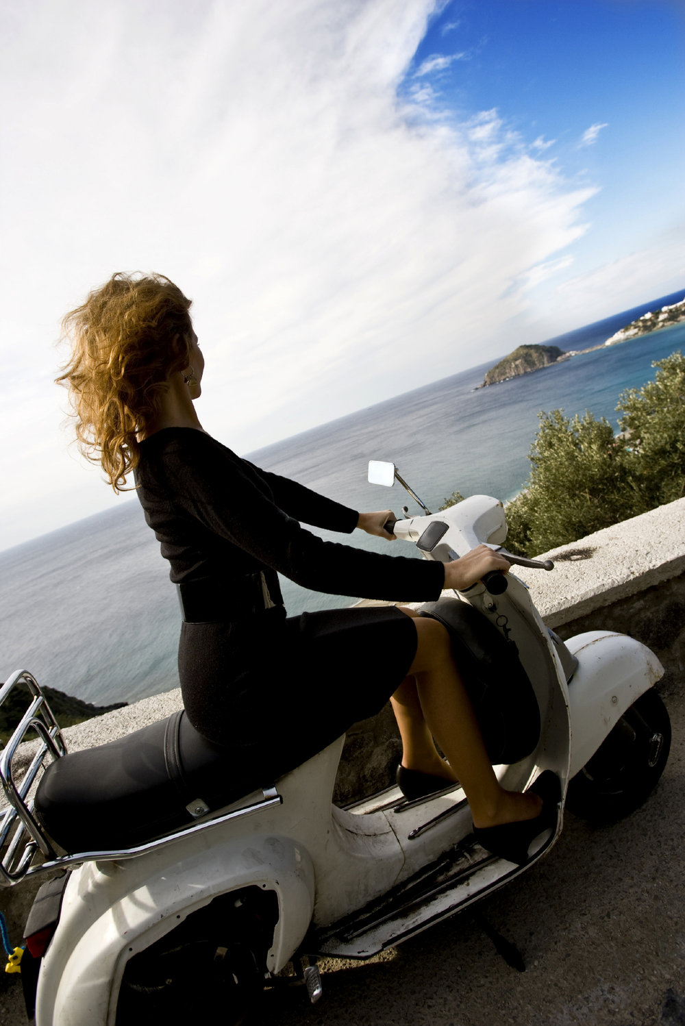 Woman on scooter overlooking ocean.jpg