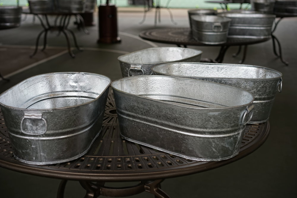 """Get a Container - At least 6"""" deep and made of natural materials. Some of my favorites are cedar, steel and terra cotta clay.Be sure to add drainage holes to the bottom of your container if it doesn't come with. Drainage is super important for lettuce plants that don't like to sit in water."""