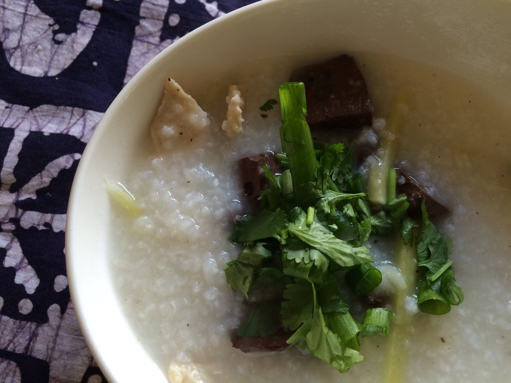 Cambodian rice porridge with pig blood curd and chicken -
