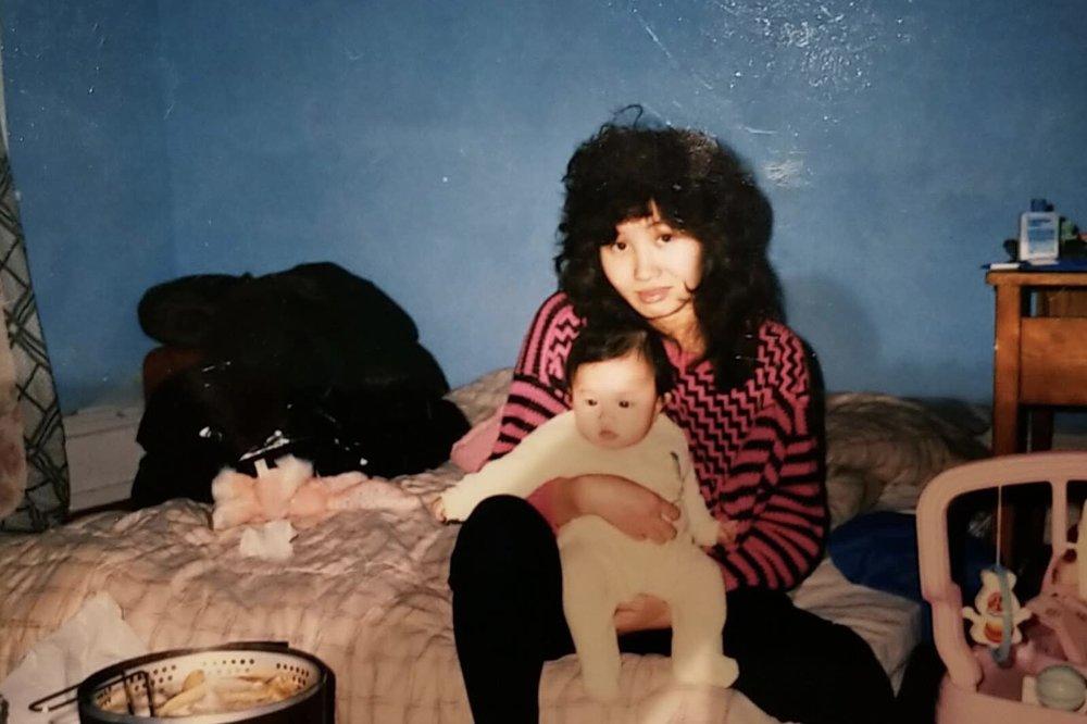 Tina's mom with Tina as a baby.jpeg