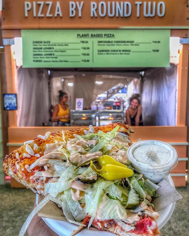 Grab a slice 🍕 @roundtwostore_la making its debut at #VeganCoachella 📸: @aveganandher