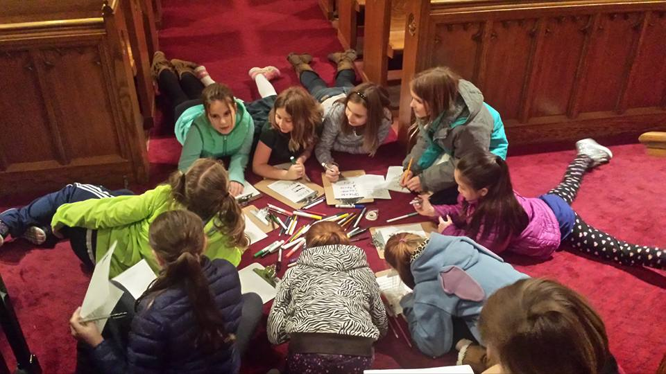 Choristers learning music during rehearsal.jpg