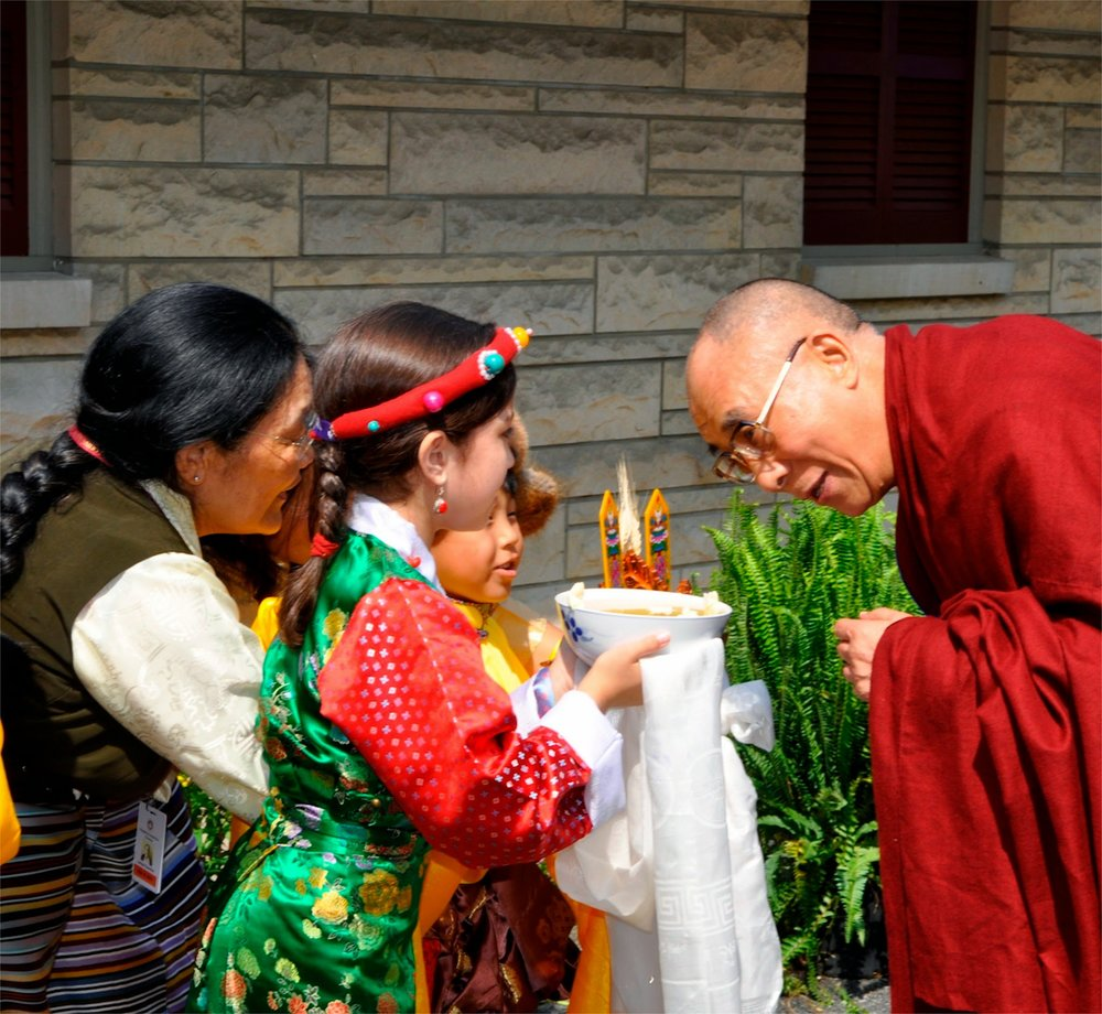 His Holiness greets children before the blessing.