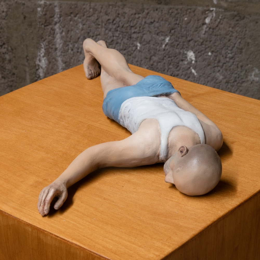 Eric Wesley  New Realistic Figures (Sleeping): Michel , 2009/2015 Paint and plastic on stained maple pedestal 3.75 x 8.75 x 18 inches, pedestal: 56 x 11.5 x 11.5 inches
