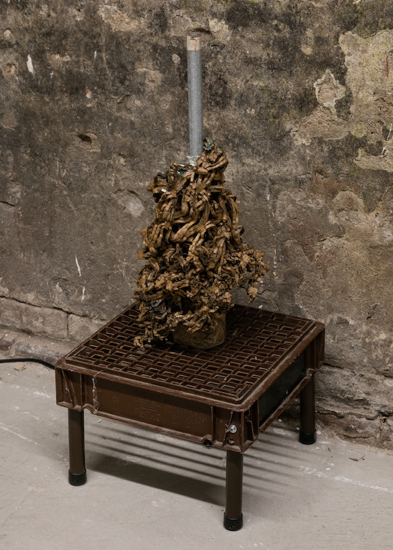 Chris Zacher  Table with flower , 2018 Milk crate, aluminum, plumbing pipe, cardboard, papier-mâché and fleece 13 x 13 x 30 inches