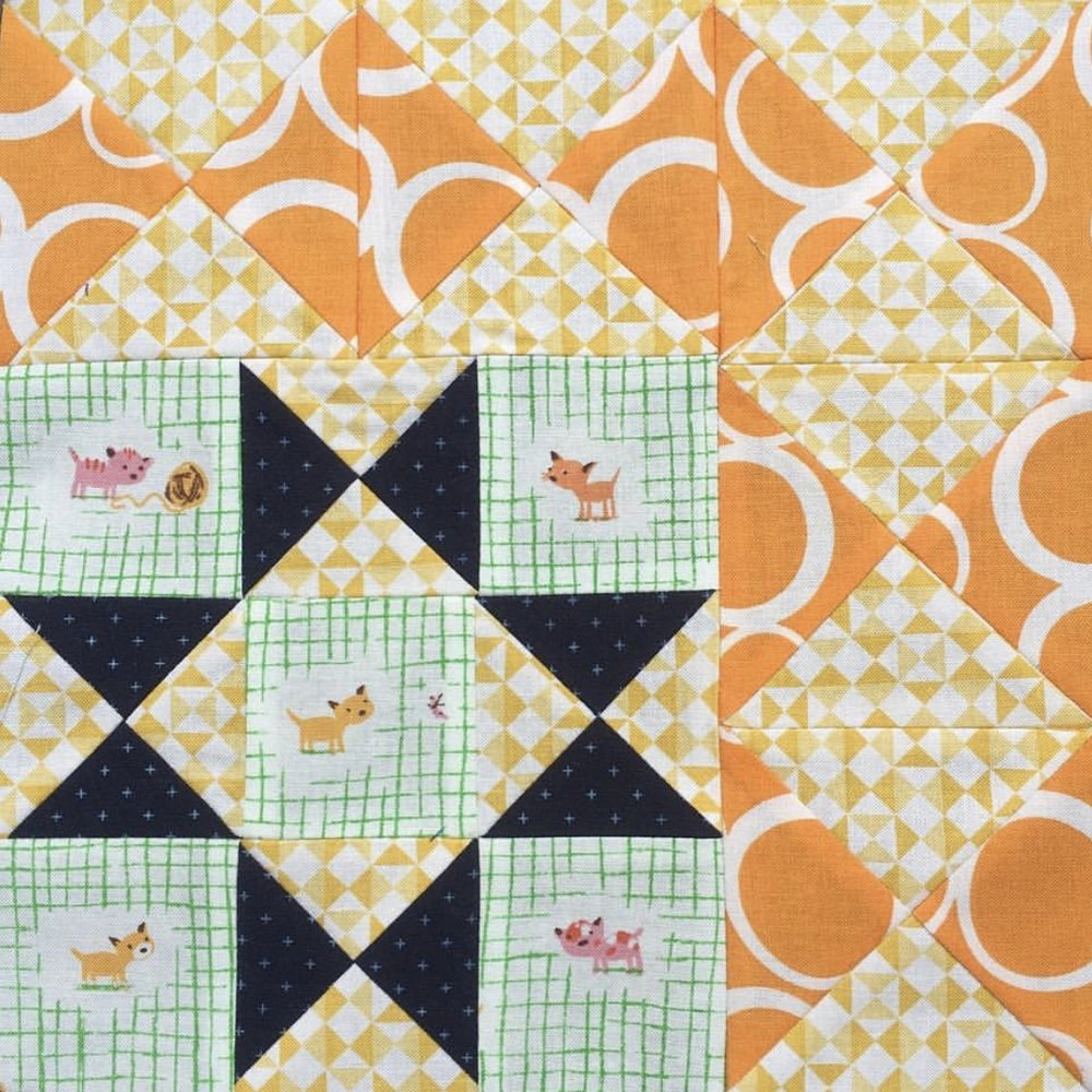 This block by  @sushi.farmer  just feels delightful to me. I love the cheerful yellows, oranges and greens with that surprise dark navy.