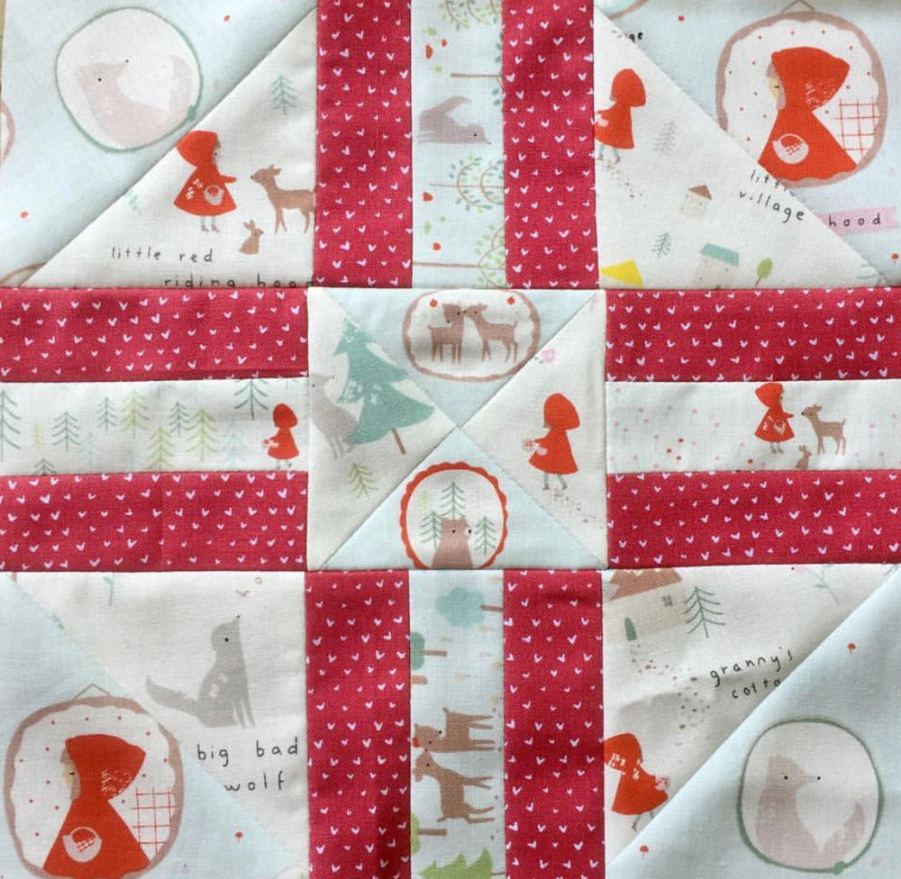 The little red riding hood narrative in  @julstreasures ' block is so perfect. It's a charming block, and I love how the reds are nicely balanced without being overwhelming.