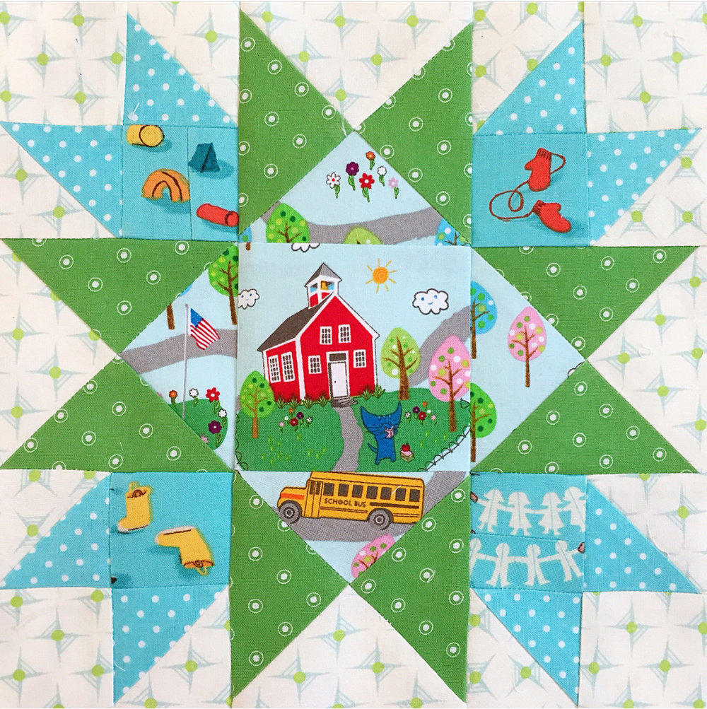 @hello.erikabea 's block just made me smile. I love how she paired Heather Ross' Kinder fabric with a sweet school, including the bus, roads and tiny little flag! Plus, her coordinates are flawless and make me think of the lessons from Block 17!