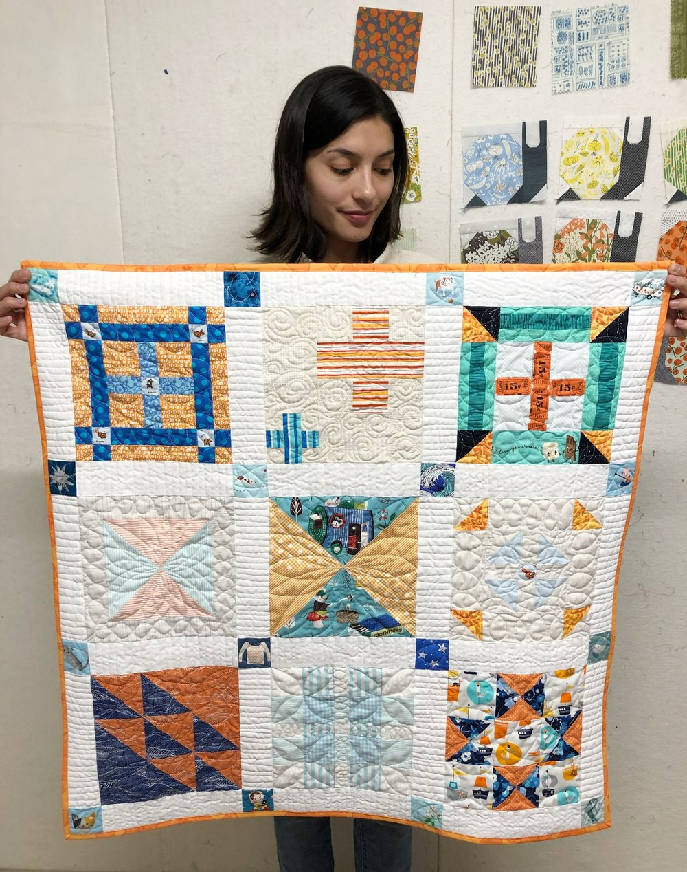 This quilt started its life as blocks created for our book,  The Fussy Cut Sampler . For one reason or another the blocks didn't end up in the final quilt, but that meant they were perfect for this surprise baby quilt!