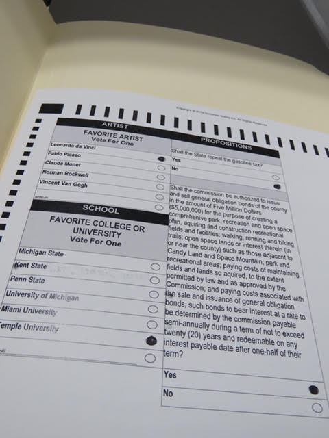 """6. Go to the table with cardboard """"study carrels"""" to fill in the circles on your ballot."""