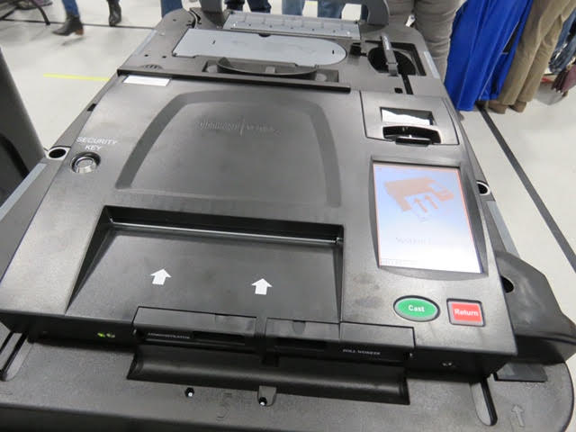 10. The arrows show you where to insert your ballot.