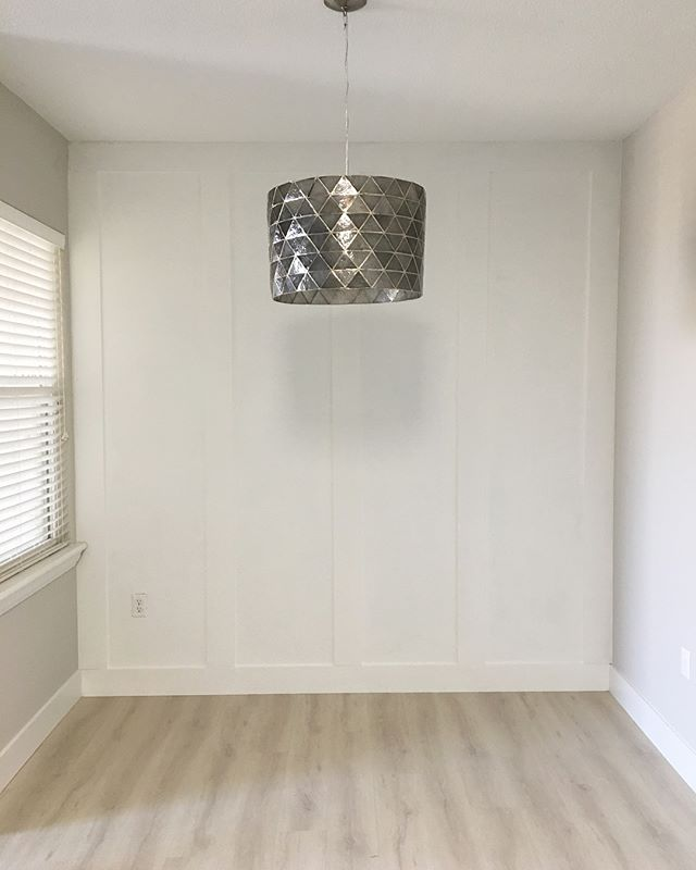 It's complete! Newly updated, custom trimmed and painted wall. I'm so proud of myself. Slide to see the before! #transformation #beforeandafter #designer #designlife #westelm #paintitwhite #kitchen #interiordesign #trend #stylist #modernhomes #customized #loveit #newspace #calistyle #remodeling #organized #bossbabe #fashionstatement