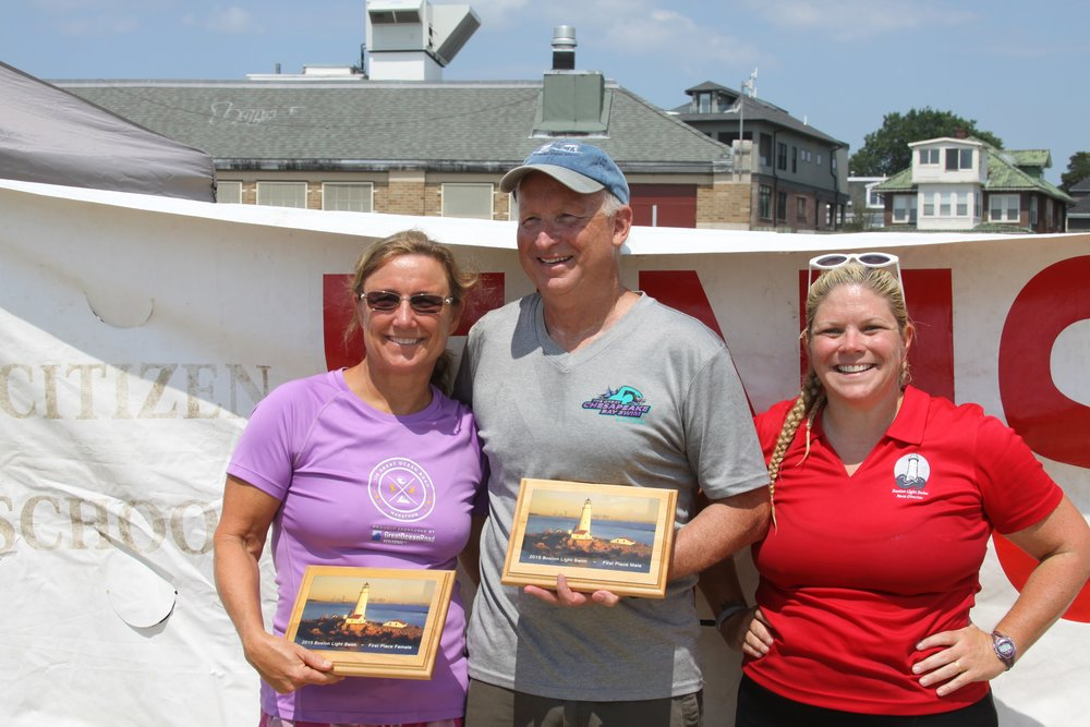 Penny Palfrey and Jim Clifford, first and second place finishers of the 2015 Boston Light Swim, with Race Co-Director, Elaine Howley
