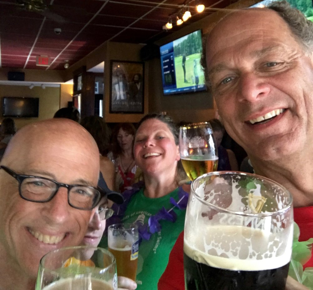 Jef Mallett, Mark Howley, Elaine Howley, and Bill Shipp celebrate the completion of another wonderful Boston Light Swim at the L Street Tavern after the 2017 race.